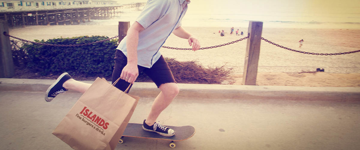 Skateboarder Holding Take Out Bag